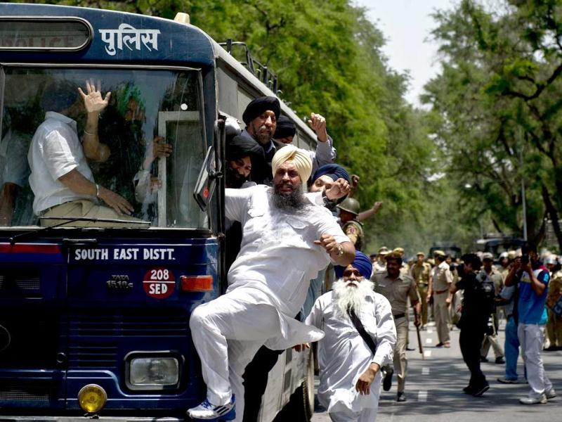 Sikh protestors shout slogans as they are taken away in a police bus following a protest outside Congress Party president Sonia Gandhi's residence in New Delhi. (AFP)