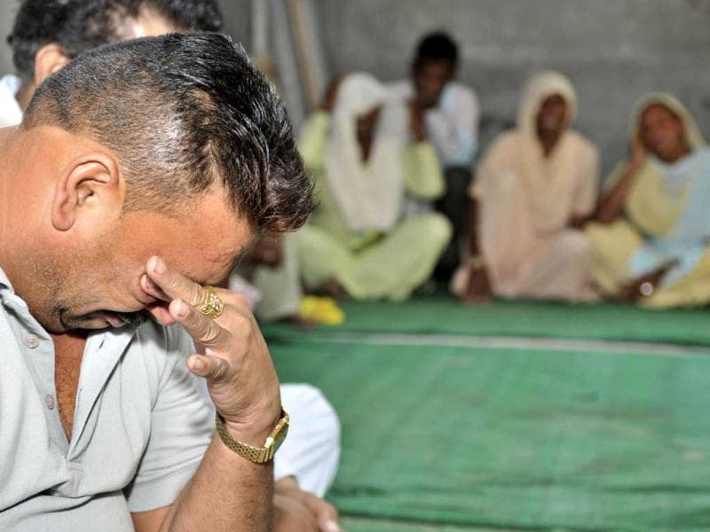 Sarabjit Singh's childhood friend Satpal Singh seen crying at Sarabjit's house in Bikhiwind village, about 40kms from Amritsar. (Munish Byala/HT)
