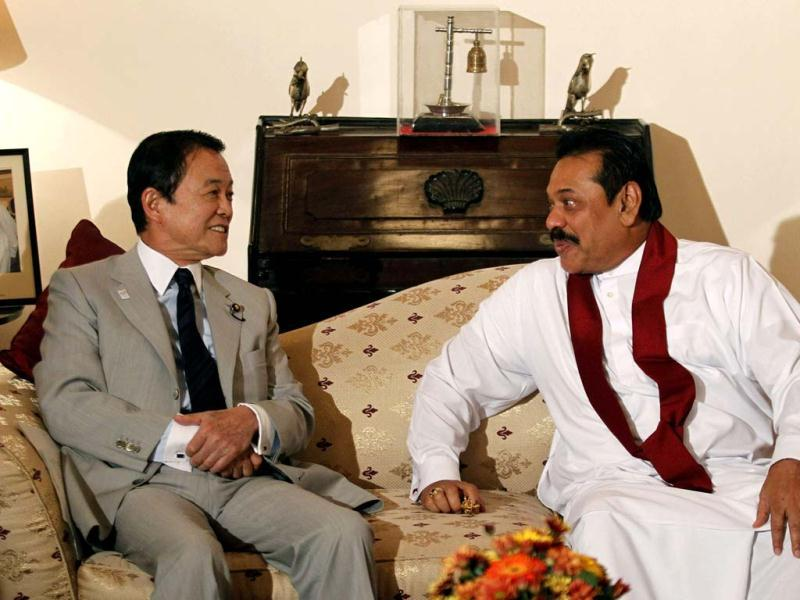 Japan's deputy prime minister and finance minister Taro Aso talks with Sri Lanka's President Mahinda Rajapaksa during their meeting in Colombo. Dinuka Liyanawatte/Reuters