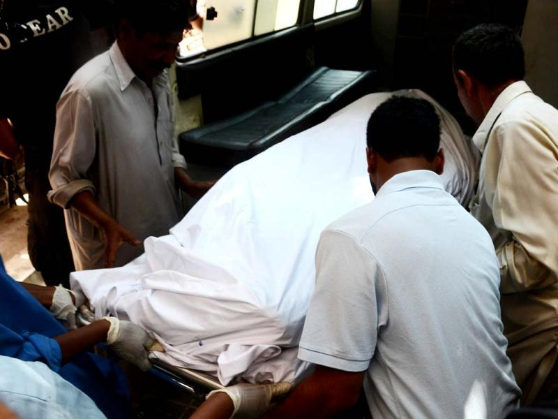 Pakistani hospital staff members shift the dead body of Sarabjit Singh, an Indian death row prisoner, into an ambulance after his post-mortem in Lahore. Arif Ali/AFP