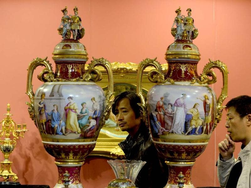 Chinese men views antiques from Austria on display at the three-day Art Beijing Contemporary Art Fair in Beijing. AFP PHOTO