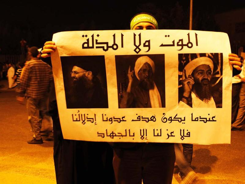Islamist protesters hold up a sign that reads,