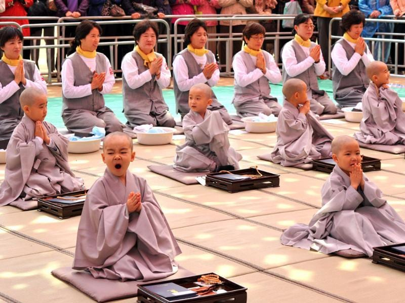 Young South Korean Buddhists attend a ceremony called