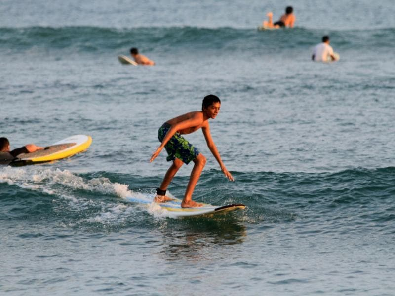 Continuing in the family tradition, the brother of Eishany Chaudhary, surfing in Hawaii