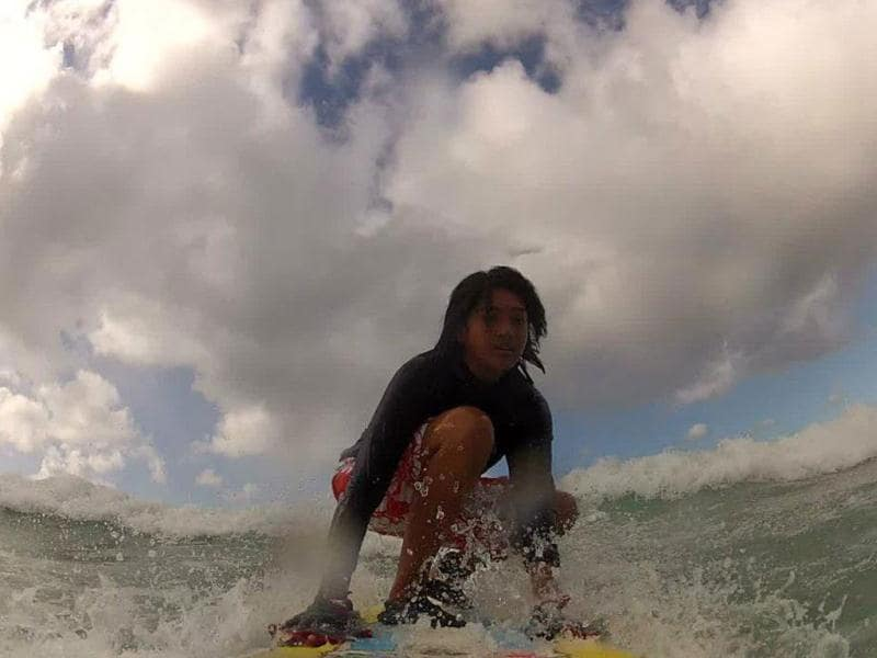 Eishany Chaudhary, surfing enthusiast and medical student from Bombay, surfing in Hawaii