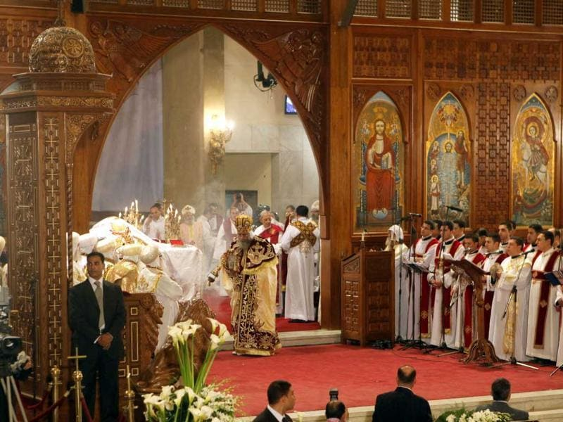 Pope Tawadros II, the 118th pope of the Coptic Church of Egypt, center, leads the Easter Mass at St. Mark's Cathedral in Cairo, Egypt. Egypt's Coptic Christians, who make up about 10% of the country's 85 million people, have long complained of discrimination by the state. AP Photo