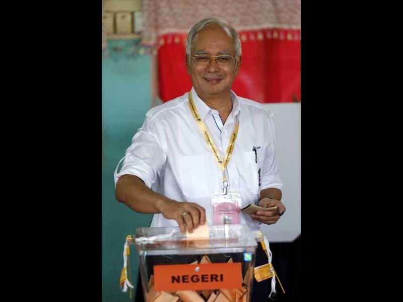 Malaysia's Prime Minister Najib Razak casts his vote during general elections in Pekan, Kuala Lumpur. Reuters