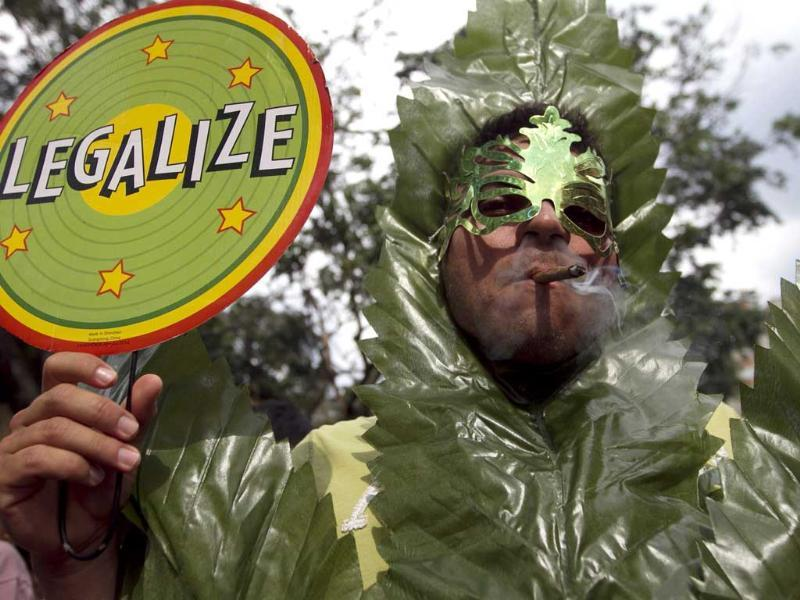 A man smokes marijuana during a demonstration in support for legalization of marijuana in Medellin. Reuters