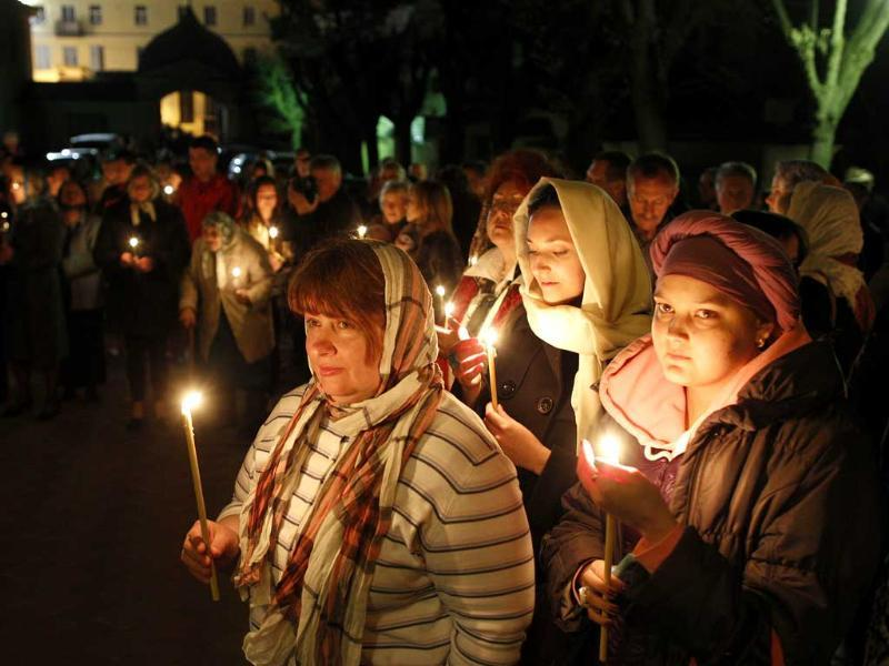 Lithuanian Orthodox Church believers hold candles during the Easter vigil mass at the Prechistensky, the Cathedral Palace in Vilnius, Lithuania. AP