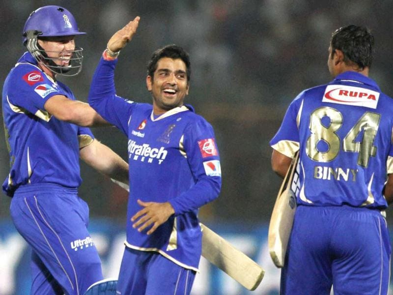 Rajasthan Royals' Stuart Binny and James Faulkner celebrate team victory over Pune Warriors India during the T20 league match in Jaipur. (PTI)