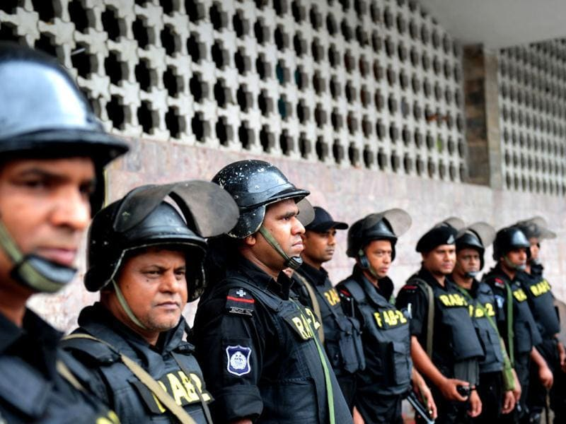 Rapid Action Battalion (RAB) personnel stand guard following a clash between police and Islamists, in Dhaka. (AFP Photo)