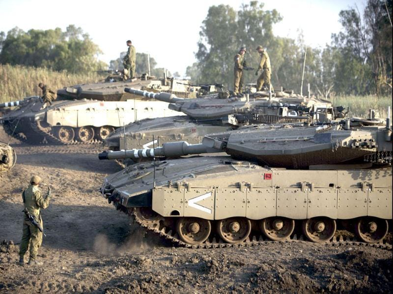 Israeli soldiers are seen with their Merkava tank unit deployed in the Israeli annexed Golan Heights near the border with Syria. (AFP)
