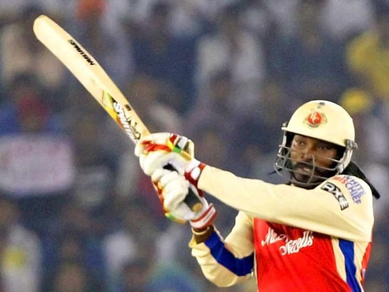 Royal Challengers Bangalore batsman Gayle plays a shot against Kings XI Punjab during the T20 league match at PCA Stadium in Mohali. PTI