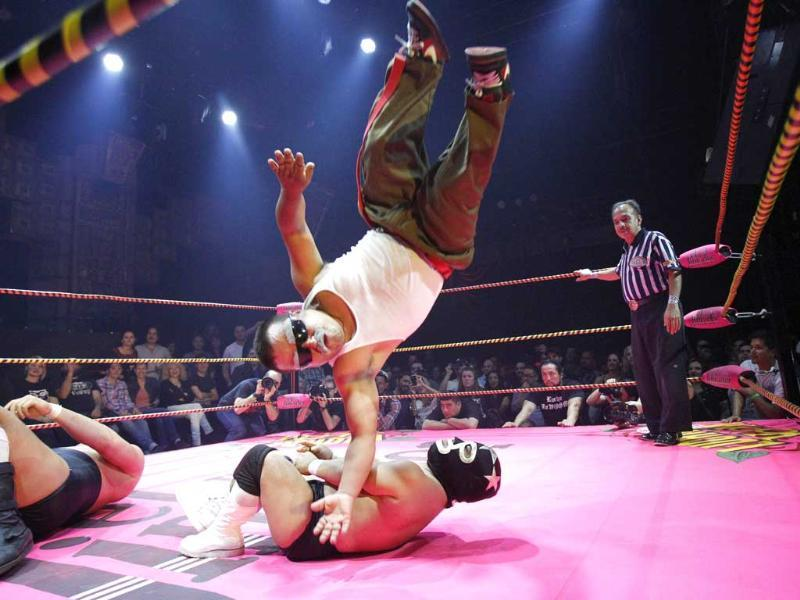 Lucha libre wrestler Cholitito leaps onto Mini Matt Classic during their fight at the Lucha Va Voom show as part of a Cinco de Mayo celebration at the Mayan theatre in Los Angeles, California. Reuters