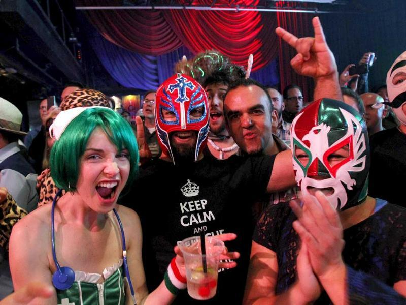 Spectators wearing masks and costumes react during the Lucha Va Voom show as part of a Cinco de Mayo celebration at the Mayan Theatre in Los Angeles, California. Reuters