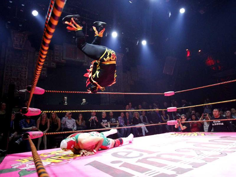 A lucha libre wrestler of The Crazy Chickens leaps in midair while fighting against Dr Maldad during the Lucha Va Voom show as part of a Cinco de Mayo celebration at the Mayan Theatre in Los Angeles, California. Reuters