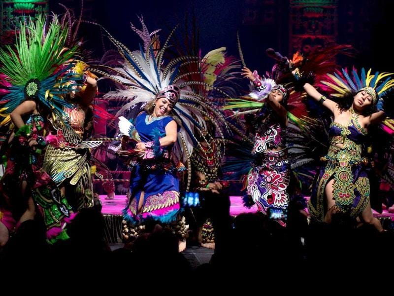 Dancers perform on stage during the Lucha Va Voom's Cinco de Mayan show at the Mayan Theatre in downtown Los Angeles, California. AFP