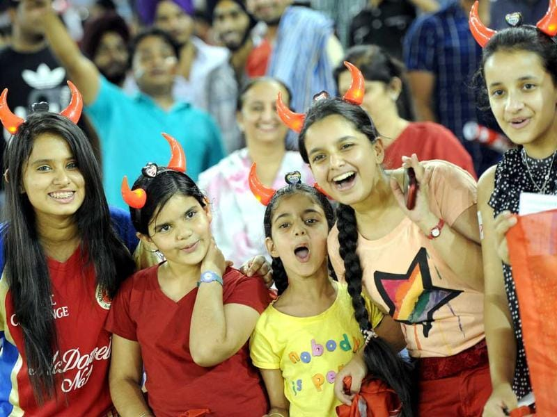 Fans enjoying the T20 cricket match between Kings XI Punjab and Royal Challengers Bangalore at PCA Stadium, in Mohali. HT Photo/Gurpreet Singh