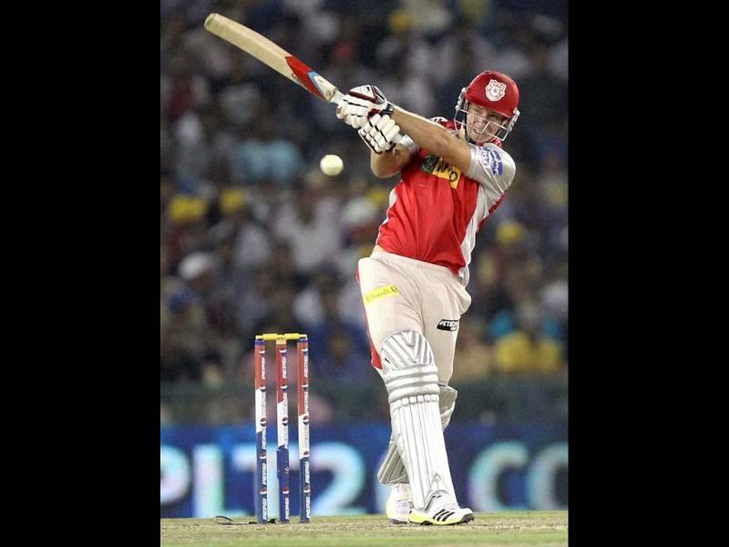 Kings XI Punjab's David Miller plays a shot against Royal Challengers Bangalore during the T20 league match at PCA Stadium in Mohali. PTI