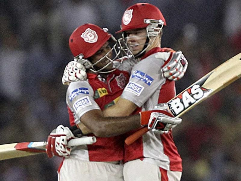 Kings XI Punjab's David Miller and R Sathish celebrate their team's victory over Royal Challengers Bangalore during the T20 league match in Mohali. PTI