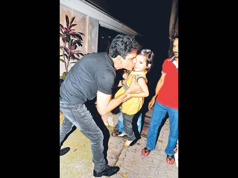 Both Manoj Bajpai and Ekta Kapoor seemed to love this baby who they met outside the party venue. (Photos: Viral Bhayani)