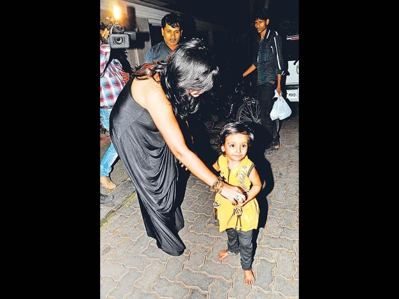 Ekta Kapoor seemed to love this baby she met outside her party venue. (Photos: Viral Bhayani)