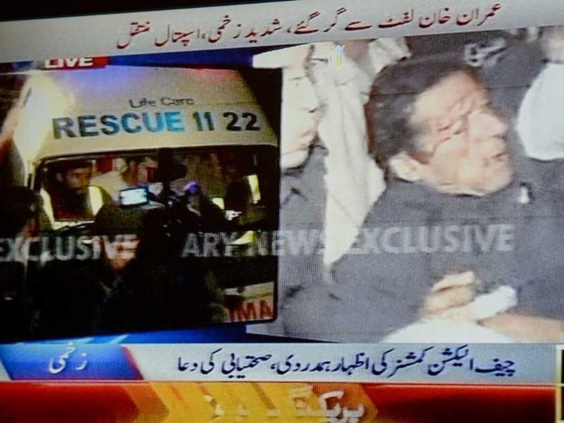 In this TV grab from ARY news, injured Pakistani politician and former cricketer Imran Khan is shifted in an ambulance, after falling off a lift at an election rally, for treatment in a private hospital in Lahore. AFP
