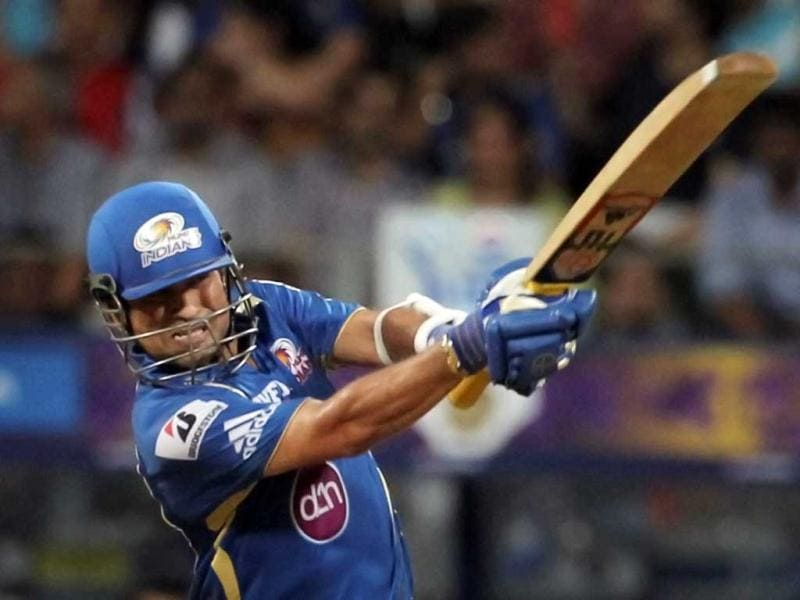 Mumbai Indians batsman Sachin Tendulkar plays a shot during the T20 league match against KKR at the Wankhade stadium in Mumbai. (PTI)