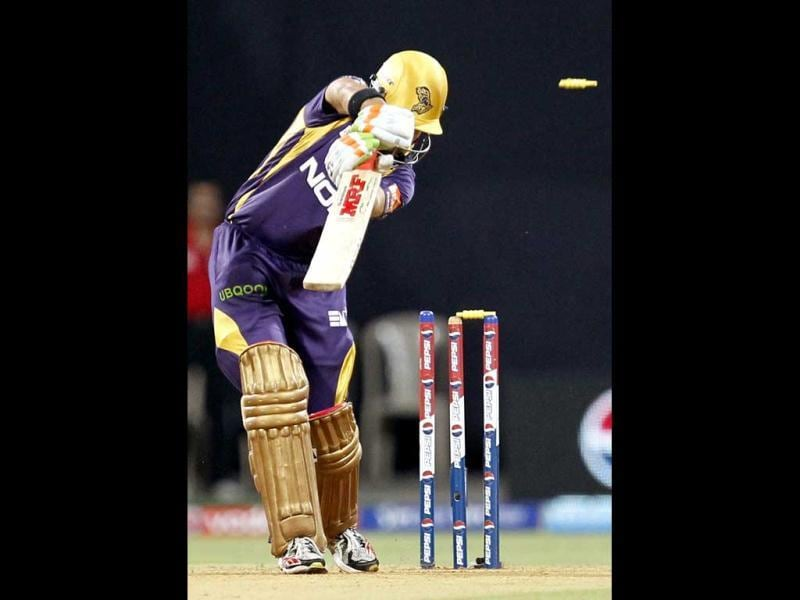 Kolkata Knight Riders' Gautam Gambhir was bowled out by Mumbai Indians' Mitchell Johnson during the T20 match at Wankhede Stadium in Mumbai. (Kunal Patil/HT)