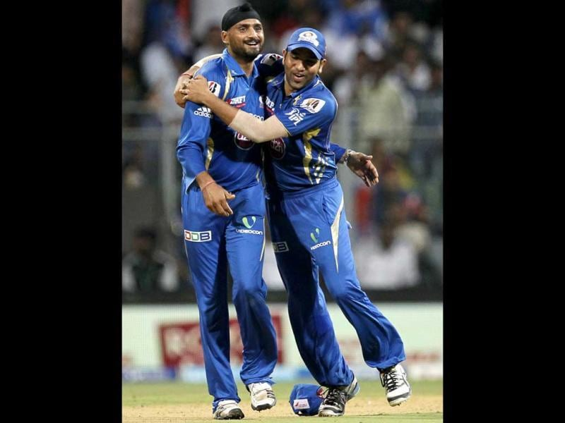 Mumbai Indians players Harbhajan Singh and Rohit Sharma celebrate the wicket of Rajat Bhatia during the T20 match against Kolkata Knight Riders at Wankhede Stadium in Mumbai. (Kunal Patil/HT)