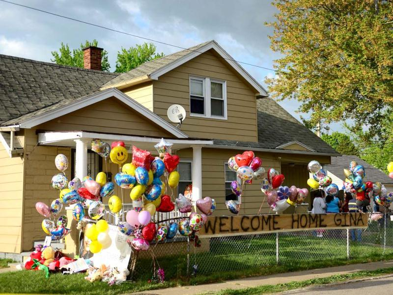 The family house of Gina DeJesus, one of the three women which were held captive for a decade, is decorated by well wishers in Cleveland, Ohio. Three brothers have been arrested in connection with the kidnapping of three women found safe in a home after being missing for a decade, authorities said. There were more questions than answers the day after the stunning turn of events that began with a frantic arm sticking out of a screen door, a woman screaming for help, and a neighbor kicking in the door to free her in a working-class neighborhood of the city in the American heartland. Ariel Castro and his brothers - Pedro, 54, and Onil, 50 have been detained, authorities said. (AFP)