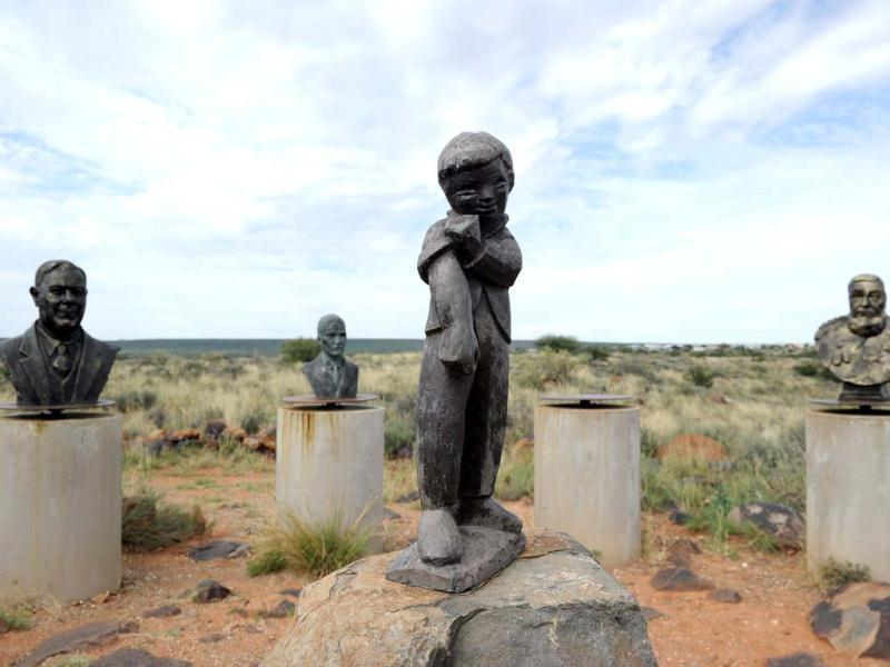 Orania town's logo of a boy rolling up his sleeves flanked by statues of apartheid heroes displayed above the town of Orania. Orania is a South Africa's only