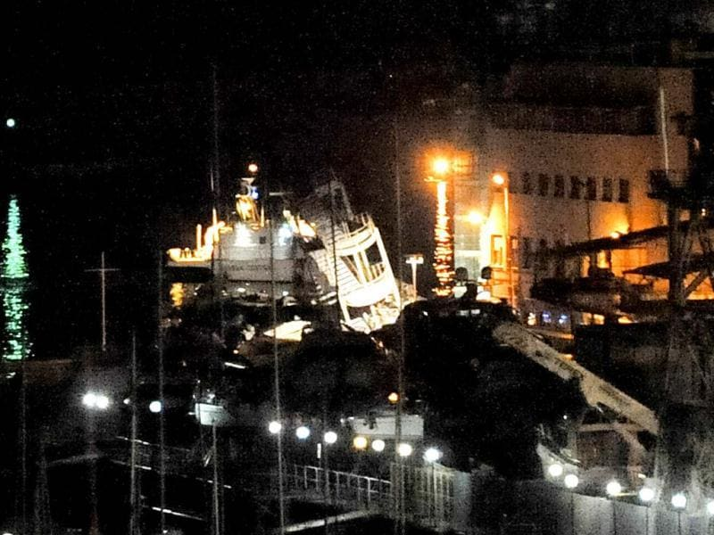The toppled control tower of the port of Genoa, northern Italy, is lit by rescuers after a cargo ship slammed into it killing at least three people. Half a dozen people remain unaccounted for early Wednesday, after a cargo ship identified as the Jolly Nero of the Ignazio Messina slammed into the port. (AP)