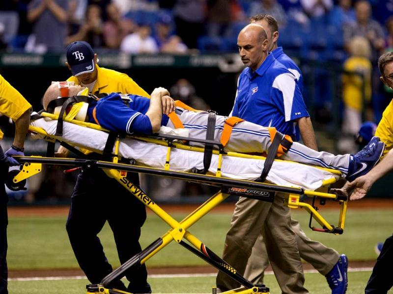 Toronto Blue Jays' pitcher J.A. Happ is wheeled off the field on a stretcher after he was injured during the second inning of their major league baseball game against the Tampa Bay Rays in St. Petersburg, Florida. (Reuters)