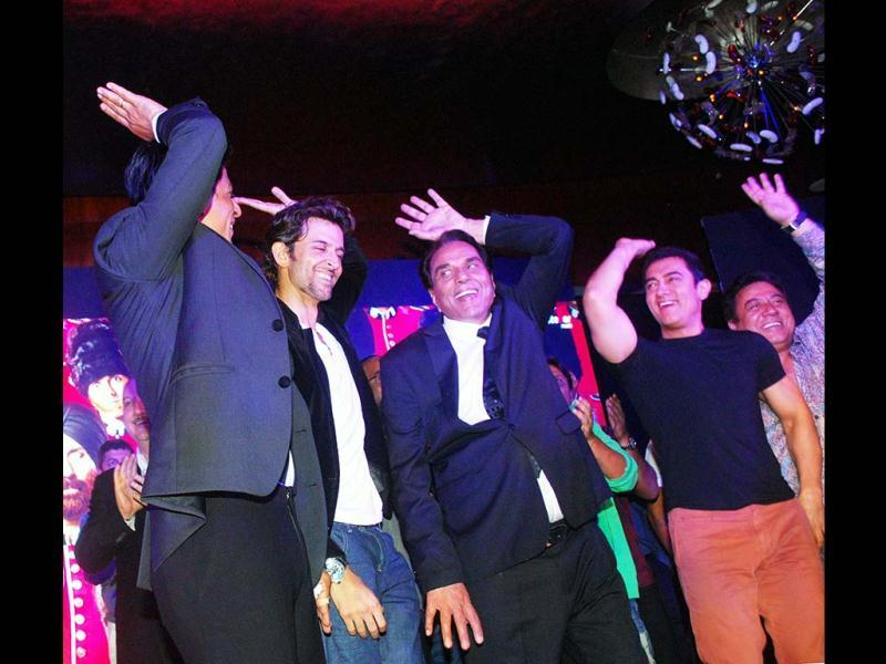 In this image, it seems Aamir Khan is facing Shah Rukh Khan as they break into dance during the event. (UNI Photo)