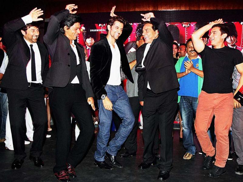 In this rare pic, Aamir Khan is seen dancing with his 'rival' Shah Rukh Khan along with Hrithik Roshan, Sunny Deol and legendary actor Dharmendra during the music launch of Yamla Pagla Deewana in Mumbai. (PTI Photo)