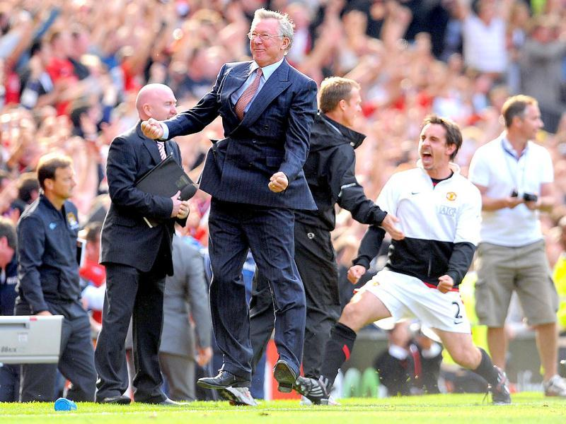 A picture taken on September 20, 2009, shows Manchester United manager Alex Ferguson celebrates after his team scored their winning goal during the English Premier League football match against Manchester City at Old Trafford, in Manchester. (AFP)