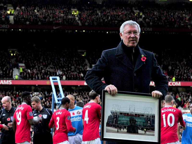 A picture taken on November 5, 2011, shows Manchester United's Scottish manager Sir Alex Ferguson is honoured by having the North Stand named after him as he celebrates 25 years in charge before the English Premier League football match between Manchester United and Sunderland at Old Trafford in Manchester. (AFP)
