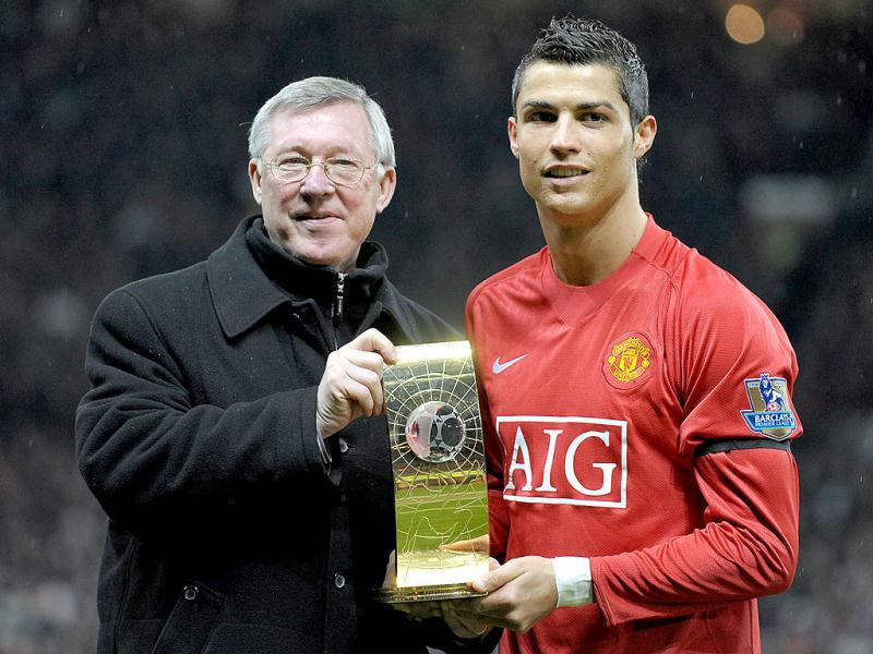 A picture taken on January 14, 2009, shows Manchester United's Portuguese midfielder Cristiano Ronaldo (R) poses with his FIFA world player of the year trophy with Manager Alex Ferguson before the English Premiership football match against Wigan at Old Trafford, Manchester. (AFP)