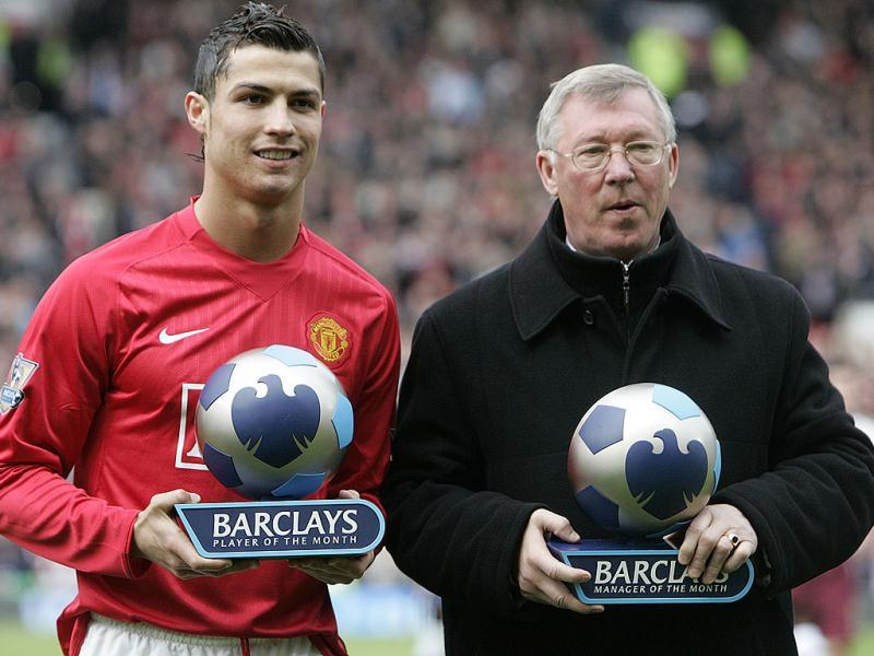 A picture taken on April 13, 2008, shows Manchester United's Portuguese midfielder Cristiano Ronaldo and manager Sir Alex Ferguson receive their player and manager of the month awards before their English Premier League football match against Arsenal at Old Trafford in Manchester. (AFP)