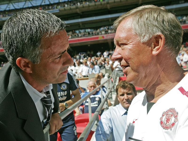 A picture taken on August 5, 2007, shows former Chelsea manager Jose Mourinho and Manchester United's Manager Sir Alex Ferguson greeting each at Wembley Stadium in London. (AFP)