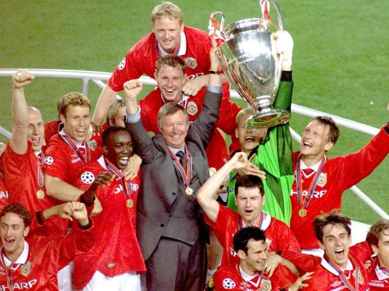 A picture taken on May 26, 1999, shows Manchester United manager Alex Ferguson celebrates with his players, after they defeated Bayern Munich in the Champions League final in Barcelona. (AFP)