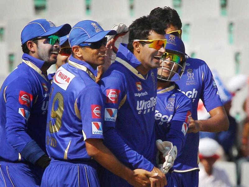 Rajasthan Royals bowler Ajit Chandila celebrates the wicket of Kings XI Punjab batsman Mandeep Singh with teammates during their T20 league match in Mohali. (PTI)