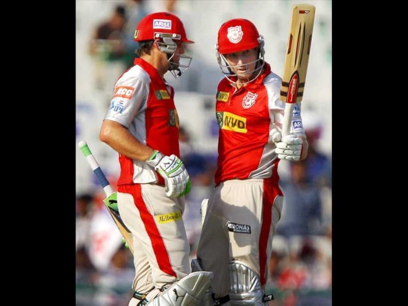 Kings XI Punjab batsman Shaun Marsh is greeted by skipper Adam Gilchrist on completing his half century during a T20 match against Rajasthan Royals in Mohali. (PTI)