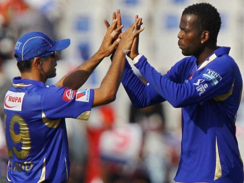 Rajasthan Royals bowler Kevon Cooper and Rahul Dravid celebrate the wicket of Kings XI Punjab batsman Adam Gilchrist during their T20 match in Mohali. (PTI)