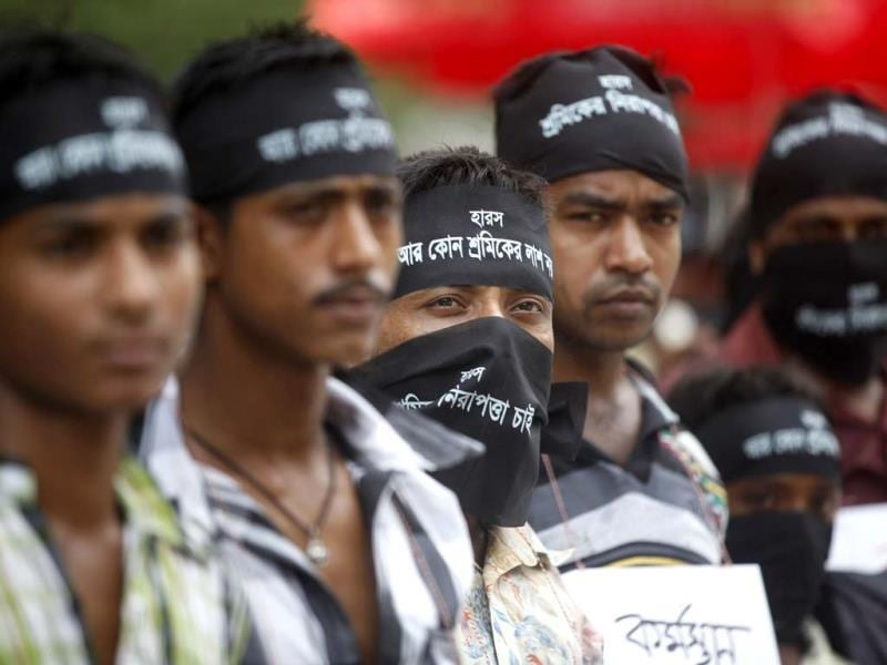 Garment workers wear headbands and cover their faces as they take part in a protest to demand capital punishment for those responsible for the collapse of the Rana Plaza building in Savar, in Dhaka. Reuters photo