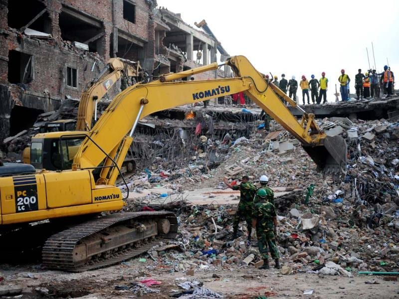 Rescuers use a digger to move debris as Bangladeshi Army personel continue the second phase of a rescue operation using heavy equipment after an eight-storey building collapsed in Savar, on the outskirts of Dhaka. AFP photo
