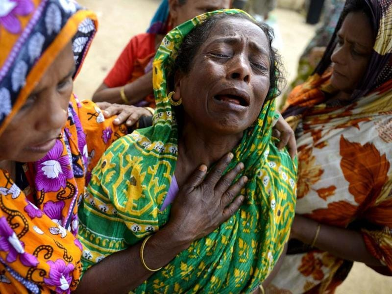 A woman grieves as the body of a relative was brought to the morgue after it was pulled out from the rubble of a garment factory building that collapsed last week in Savar, near Dhaka. AP photo