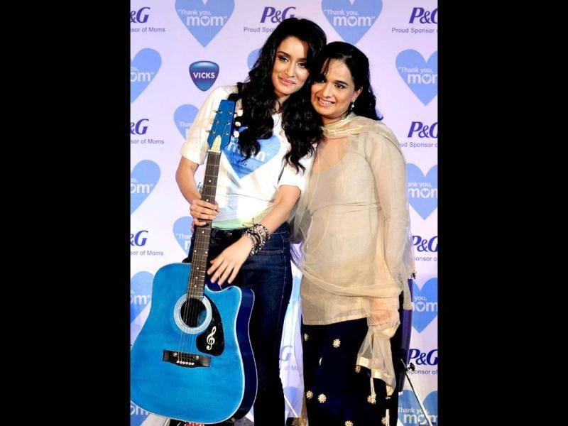 Shraddha Kapoor strikes a cute pose with her mom Shivangi Kapoor during a promotional event. (AFP Photo)