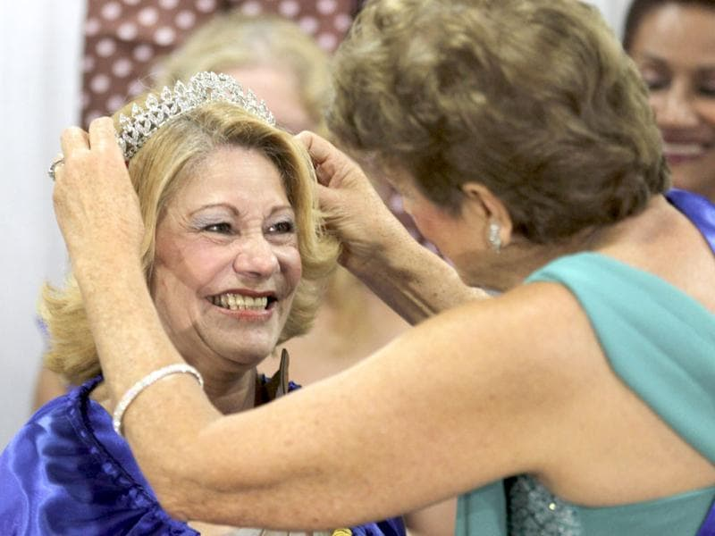 Irenilda de Oliveira Menezes, 65, receives is crowned with the tiara after winning the Sao Paulo's Elderly Women Beauty contest in Sao Palo. The contest with 25 candidates is part of Mothers' Day celebrations which will be celebrated in Brazil on May 12. REUTERS